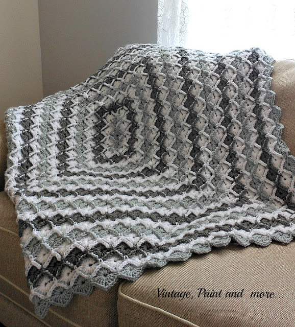 Vintage, Paint and more... crochet afghan done in a diamond pattern with white, grey and charcoal color yarns