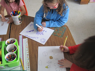students coloring shapes