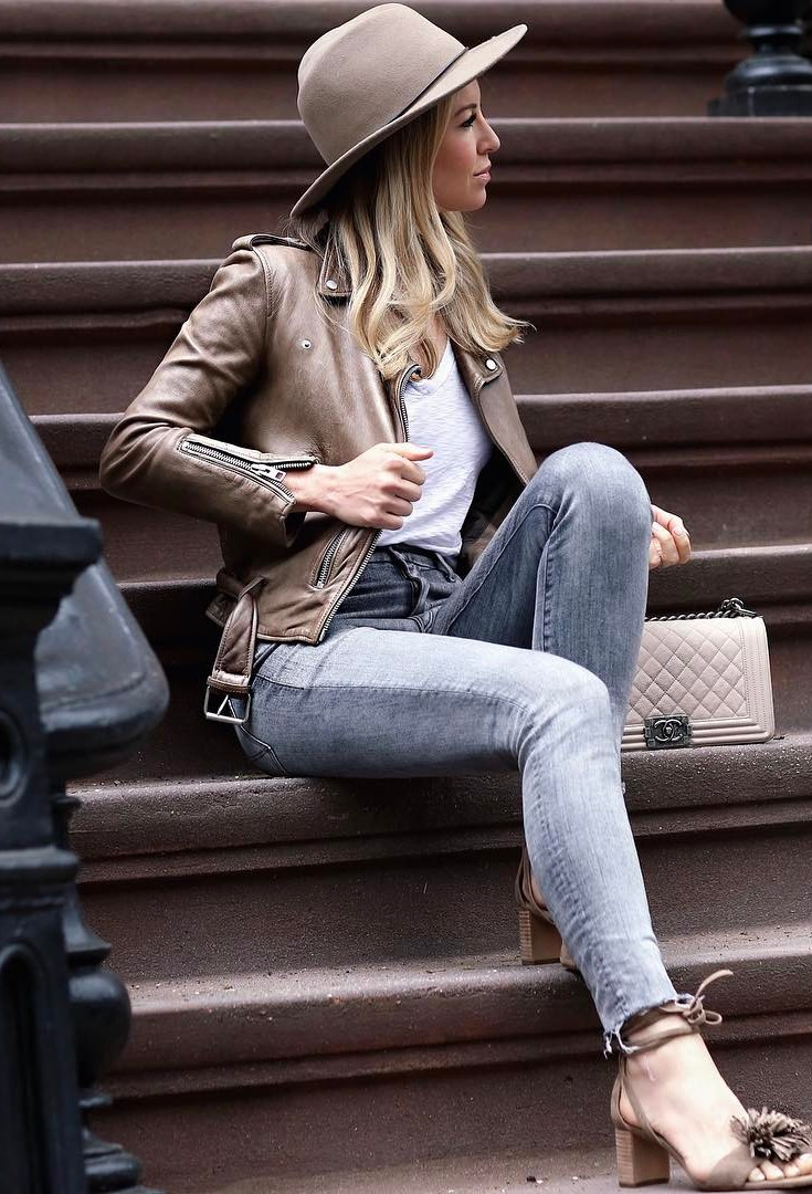 trendy fall outfit idea / hat + skinny jeans + heels + bag + biker jacket + top