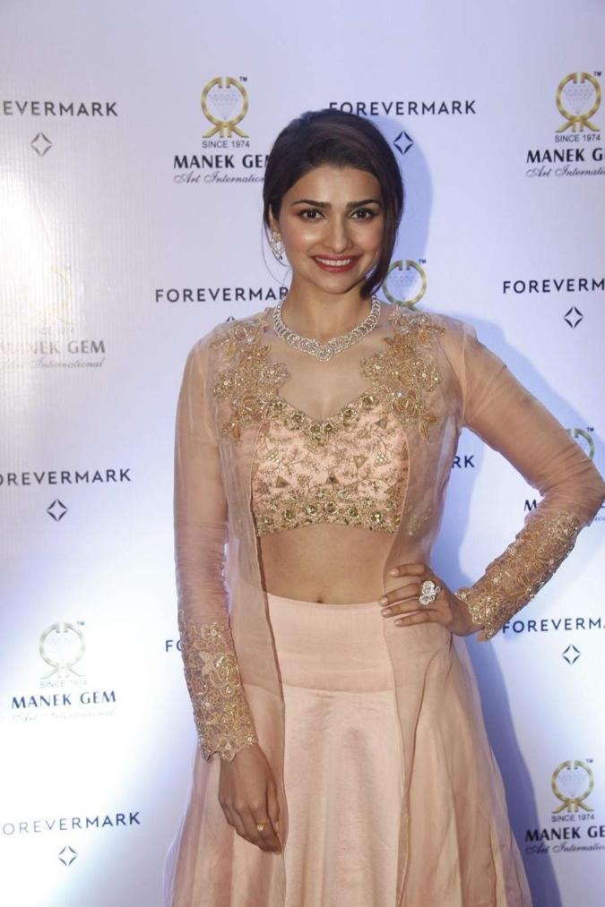 Beautiful Surat Actress Prachi Desai Cute Smiling Stills In Pink Dress