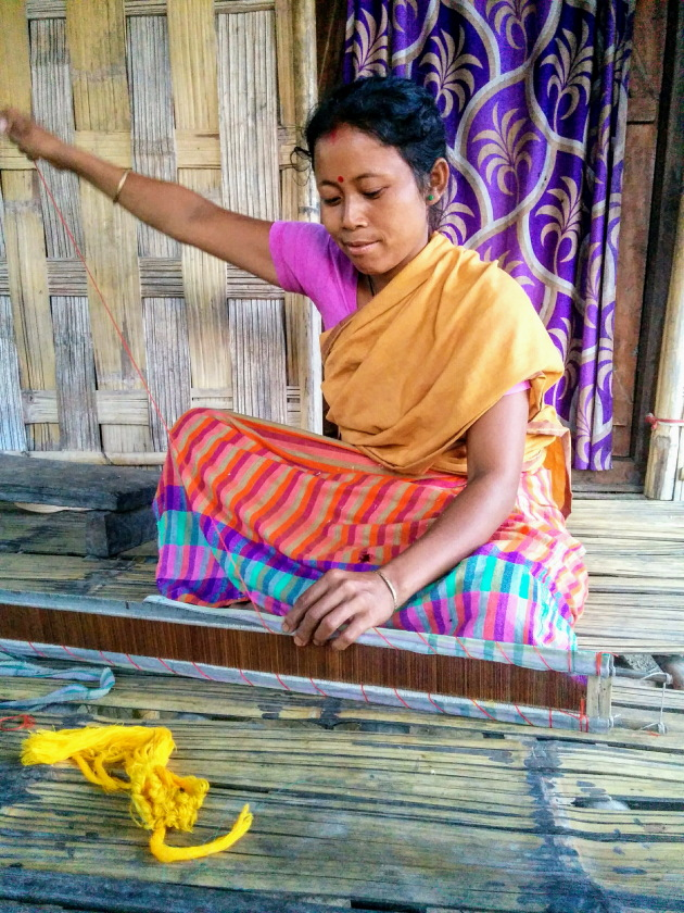 Traditional loom being prepared by hand by Mishing Tribe woman, Assam