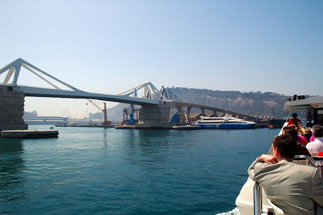 Porta de Europa Bridge as seen from sightseeing boat in Barcelona harbor