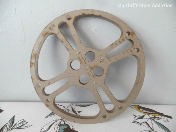 Vintage movie reel BEFORE repurpose as chalkboard frame