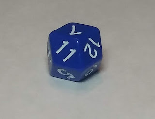 A blue d12 manufactured in such a way as to have each face shaped like a diamond rather than a pentagon.