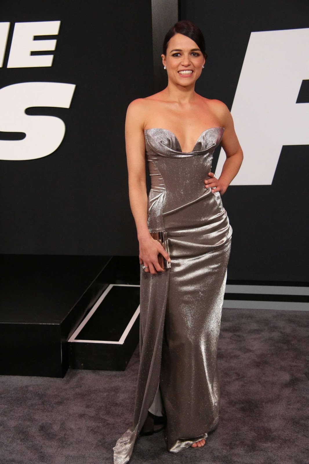 Michelle Rodriguez wears plunging metallic gown to the Fate of the Furious NY premiere