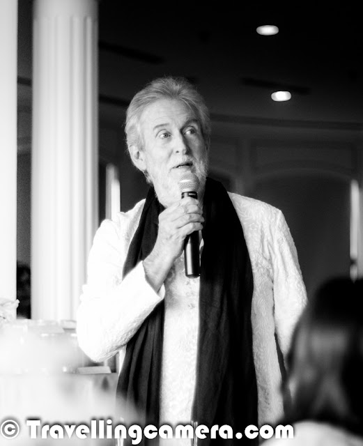 It was a beautiful evening when Tom Alter was presenting great poerty at Le Meridien, New Delhi. Travellingcamera team was also invited. This Photo Journey shares some moments from the same evening. We also shot some videos which are yet to be processed & shared. So let's enjoy these photographs and share your feedback/suggestions.Which version do you like ? The Black & White one or colored version? Above photograph shows two of my favorite people from the evening - Tom Alter & Shreen, both are awesome poets ! Above photograph shows the moment when Shreen asked him to guess her name. Actually she has done a play with Tom Alter and she gave different hints to guess the name & recall about their last meeting. I loved this interaction.This was first time I was seeing Tom Alter live in front of me. Three years back, I went to Alliance Francaise to watch Mirza Galib but cast was different, so missed seeing him.Tom Alter was here with the Tea Expert Anamika Singh/ With amazing poetry by Tom Alter, we had amazing Anandini Tea at Le Meridien, Delhi.Tom had a fabulous entry into the hall where everyone was waiting eagerly to see him & listen to his poetry. He also presented poems written by other famous poets !!His poems were quite apt for the whole environment and theme of the evening !Tom Alter is native of Mussoorie and the son of American Christian missionaries of English and Scottish ancestry and has lived for years in Mumbai and the Himalayan hill station of Landour. His father was born in Sialkot, now in Pakistan. His elder sister Martha Chen has a PhD in Sanskrit and his brother John is a poet and a teacher. He studied at the Film and Television Institute of India. His major inspiration to enter films was Rajesh Khanna.During the evening he presented different poems along with appropriate songs. It was quite apt from his impressions that he quite enjoys poems & music. His presence really changes the whole environment of the hall full of media, Bloggers & tea lovers etc.Check out more about Tom Alter @ http://en.wikipedia.org/wiki/Tom_Alter