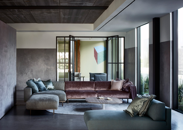Modern luxury sectional in living room minimal sophisticated interior design by Piet Boon