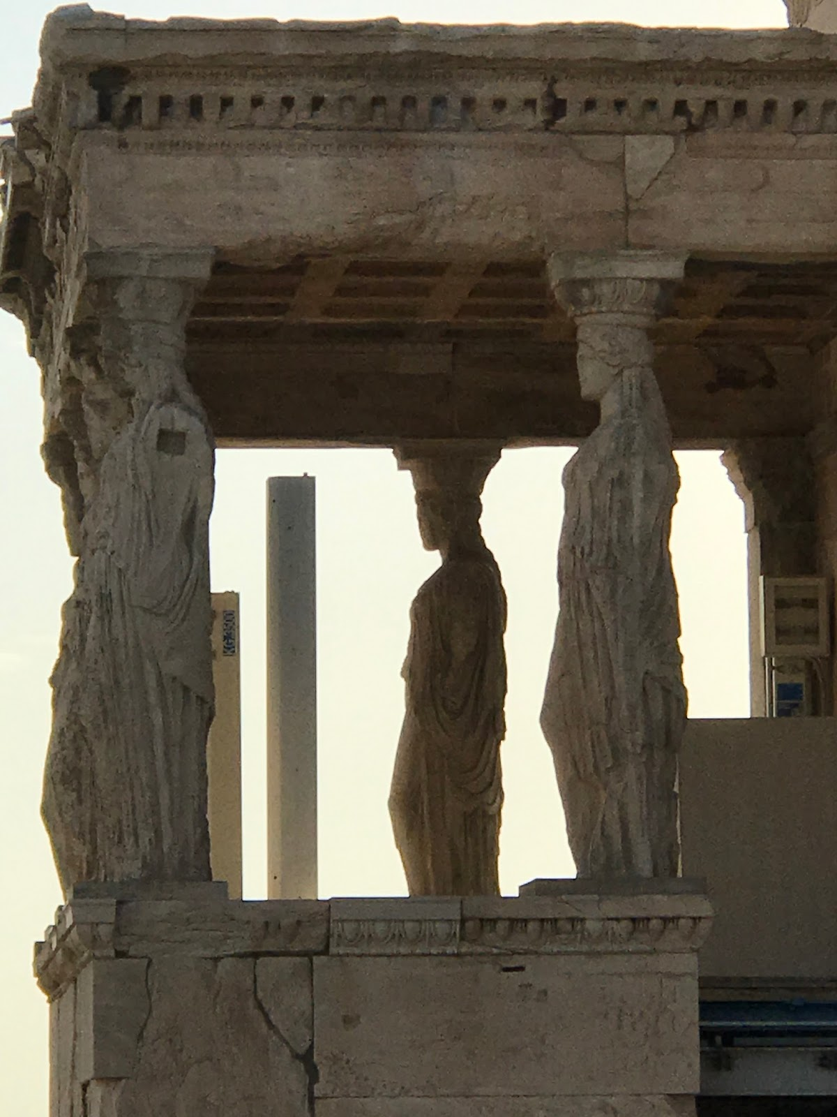 the glitter globe caryatids at the acropolis in athens greece