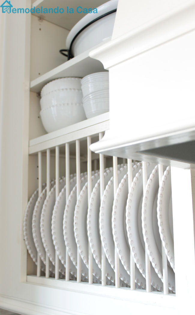 an inexpensive diy plate rack is installed inside the cabinet