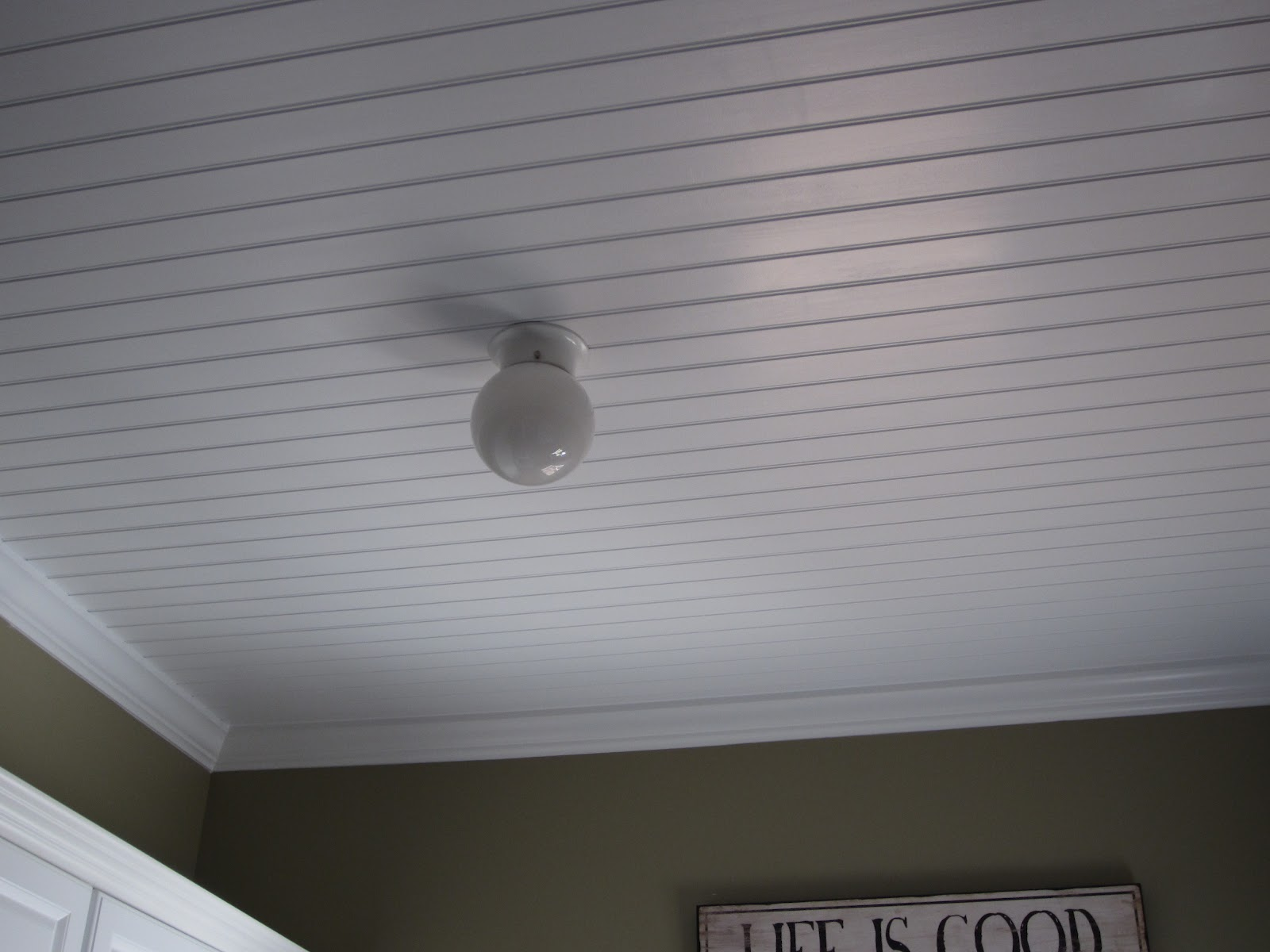 Beadboard ceiling in laundry room