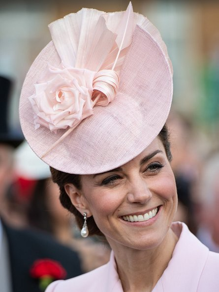 Kate Middleton wore a bespoke soft pink coatdress by Alexander McQueen. Loeffler Randall clutch. Countess of Wessex