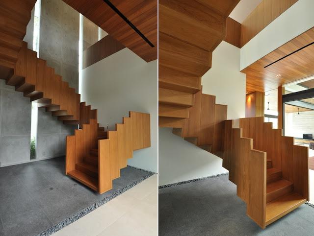 todo el espacio interior gira en torno a una contundente e escalera realizada ntegramente en madera de teca que representa el punto focal ms