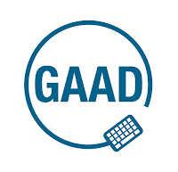 GAAD Logo: The GAAD logo has the letters G A A D in the center, written all in capital letters surrounded by a keyboard with the attached cord encircling the letters