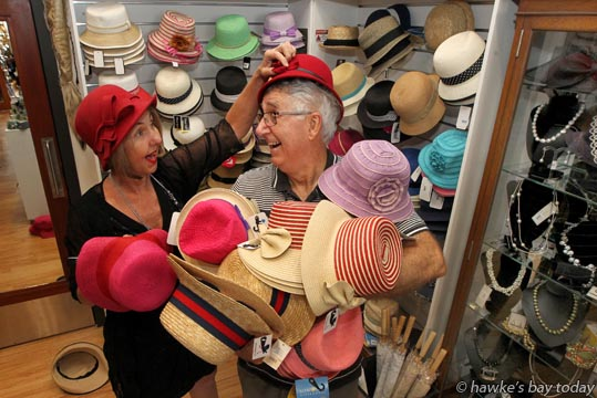 L-R: Lynda Begley, retail manager, Rick Kibblewhite, gofer, volunteer, in the hat department of the Art Deco Shop, Napier. photograph