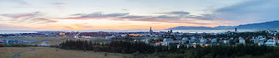 Panoramic photo of Reykjavík seen from Perlan in summer during sunset. As seen in the picture Reykjavík is mild enough to permit the growing of trees.