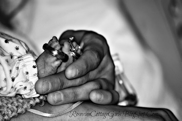 Baby Carter - Trisomy 13 - little baby feet with parents rings on them a mother's hand lovingly holding them | infant loss \ rosevinecottagegirls.com
