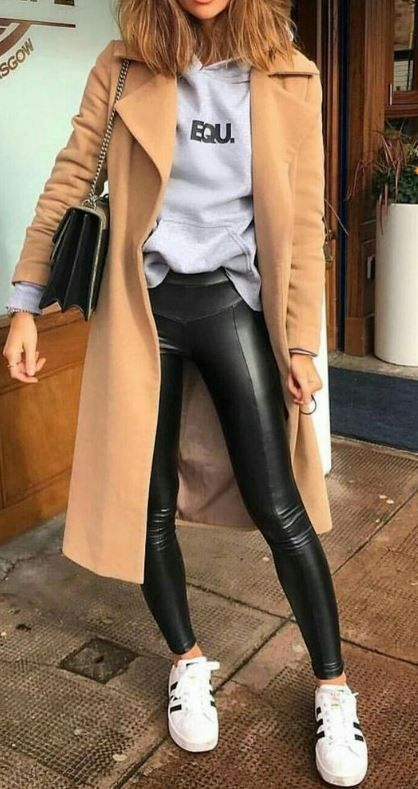 what to wear with a nude coat : bag + hoodie + black leather skinneis + sneakers