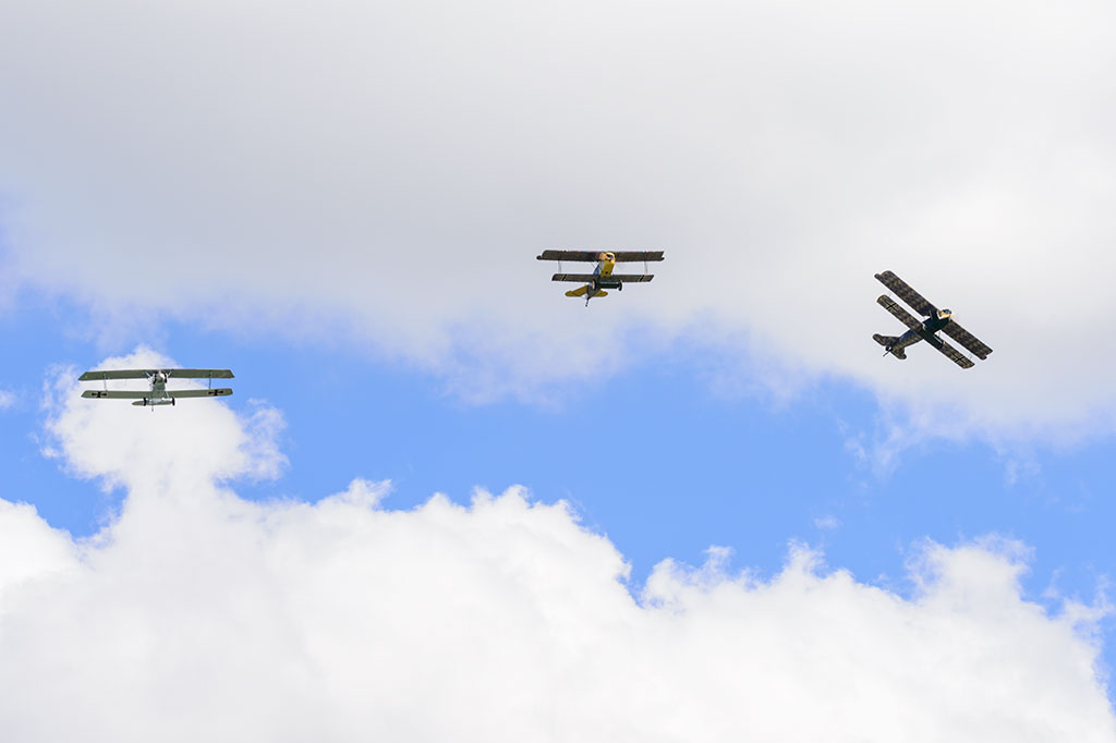 Biplanes flying in formation