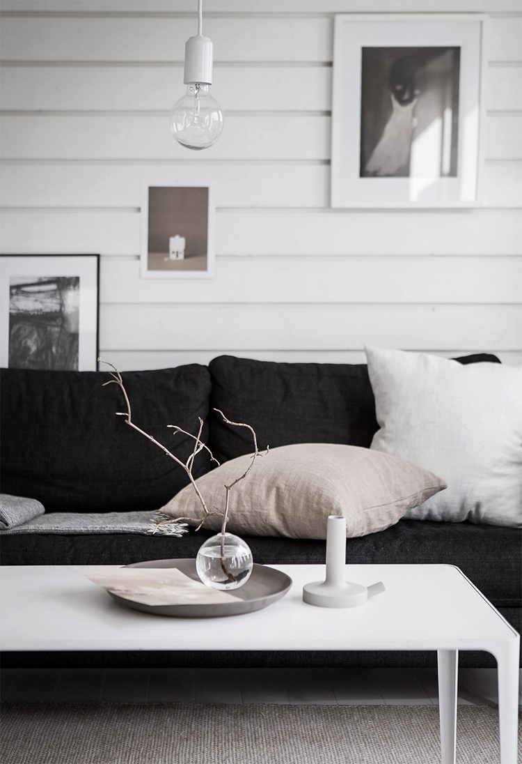 Scandinavian living room with shiplap walls by Cim Ek