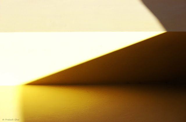 A Minimalist Photo of Lines in zig-zag created by a combination of light and shadow.
