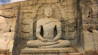 Buddha-rock-statue-sitting-meditation-peace-image.jpg