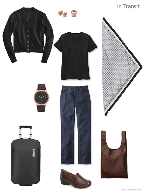 travel outfit in black and denim with brown leather accents