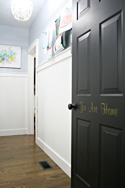 black doors with white beadboard