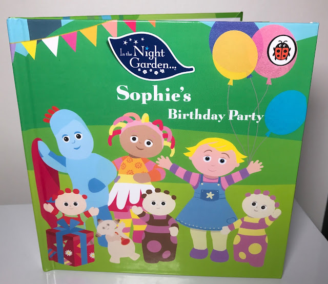 "The Front Cover of a book saying ""Little's Birthday Party"", and showing characters from In The Night Garden and an extra new character"