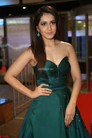 Raashi Khanna in Dark Green Sleeveless Strapless Deep neck Gown at 64th Jio Filmfare Awards South ~  Exclusive 117.JPG
