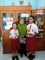 Sang juara dan Ibu Kasminah