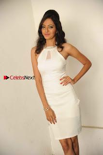 Kannada Actress Nidhi Latest Pos in White Short Dress at Vega Movie Launch Press Meet  0004.jpg
