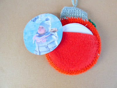back of Crochet round christmas bauble  photo frame with picture