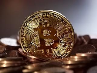 Bitcoin Makes a Sharp Drop Pile of Bitcoins.