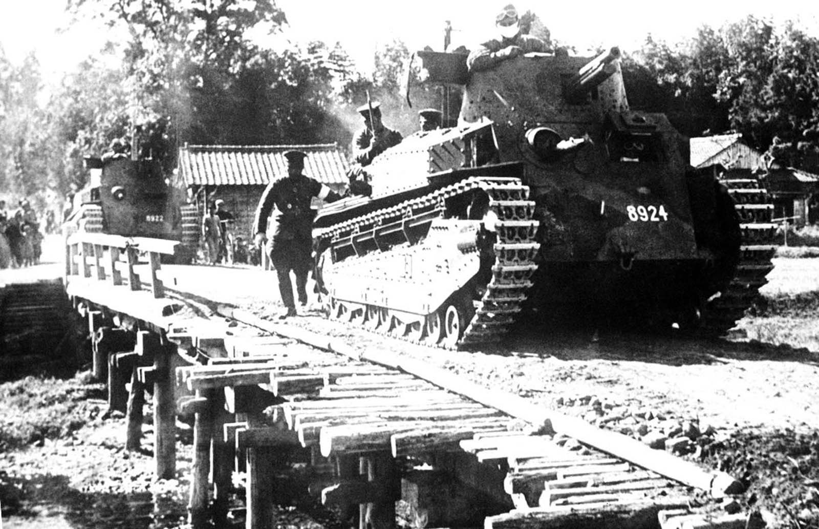 A Japanese tank passes over an emergency bridge, somewhere in China, on June 30, 1941.
