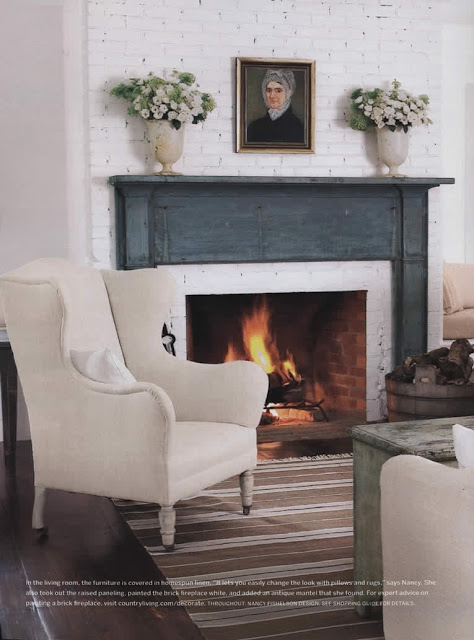 blue fireplace mantel and cream wingback chair