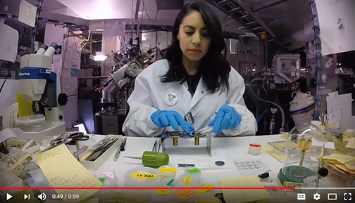 snapshot from video of a student working in a nanotech lab