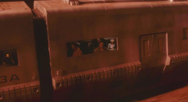 Schwarzenegger (Quaid/Hauser) on Mars train - Total Recall 1990 movie image