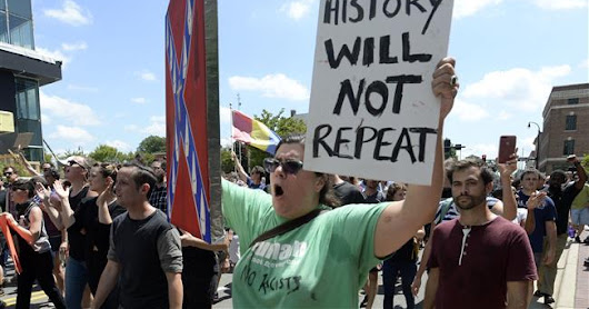 Hundreds of anti-racist protesters march in Durham, North Carolina after KKK rally rumors