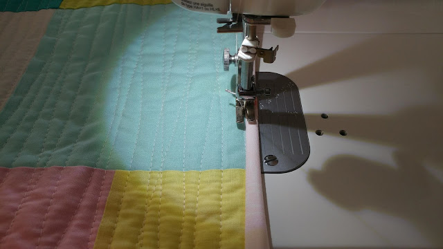 Binding a quilt by machine