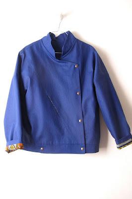 Veste bleue Matières à réflexion