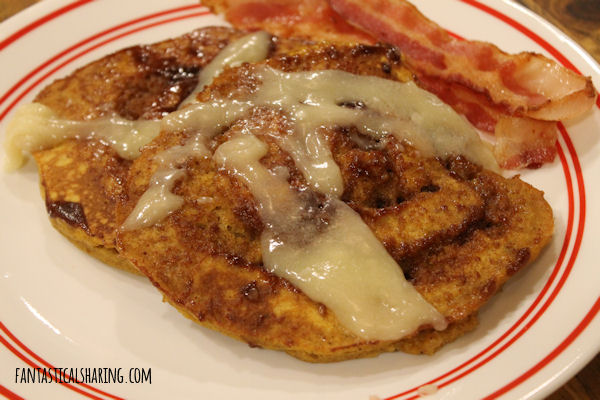 Pumpkin Cinnamon Roll Pancakes // Pancakes have never been better with a good helping of pumpkin and cinnamon sugar swirl #breakfast #pumpkin #recipe #pancakes