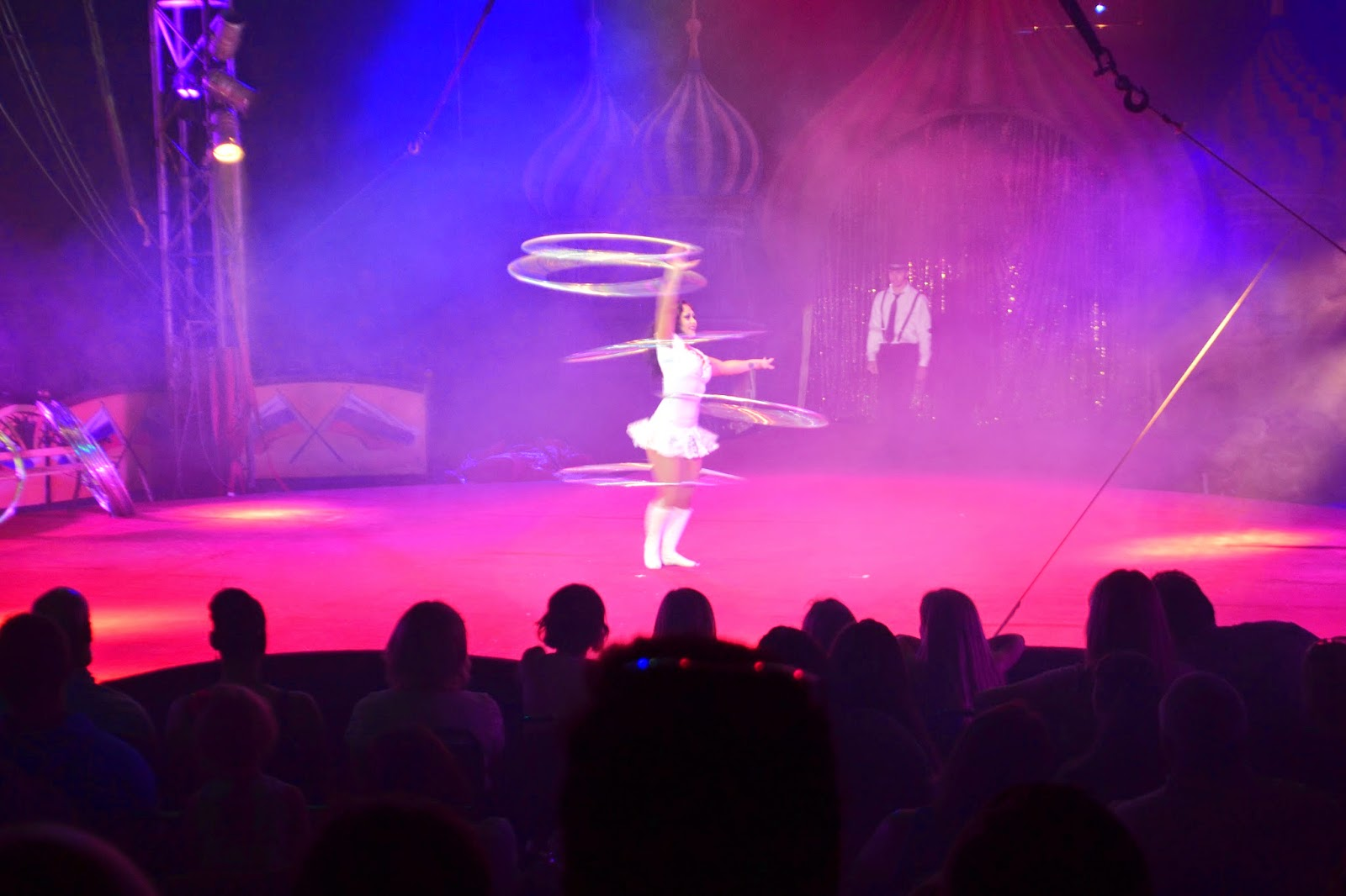 a hula hoop girl spinning at least 5 hula hoops around herself