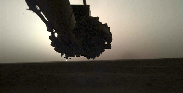 NASA's InSight lander used its Instrument Deployment Camera (IDC) on the spacecraft's robotic arm to image this sunrise on Mars on April 24, 2019, the 145th Martian day (or sol) of the mission. This was taken around 5:30 a.m. Mars local time. Credit: NASA/JPL-Caltech