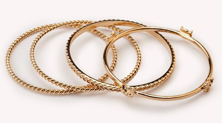 A set of four braided bangles featuring owl accents