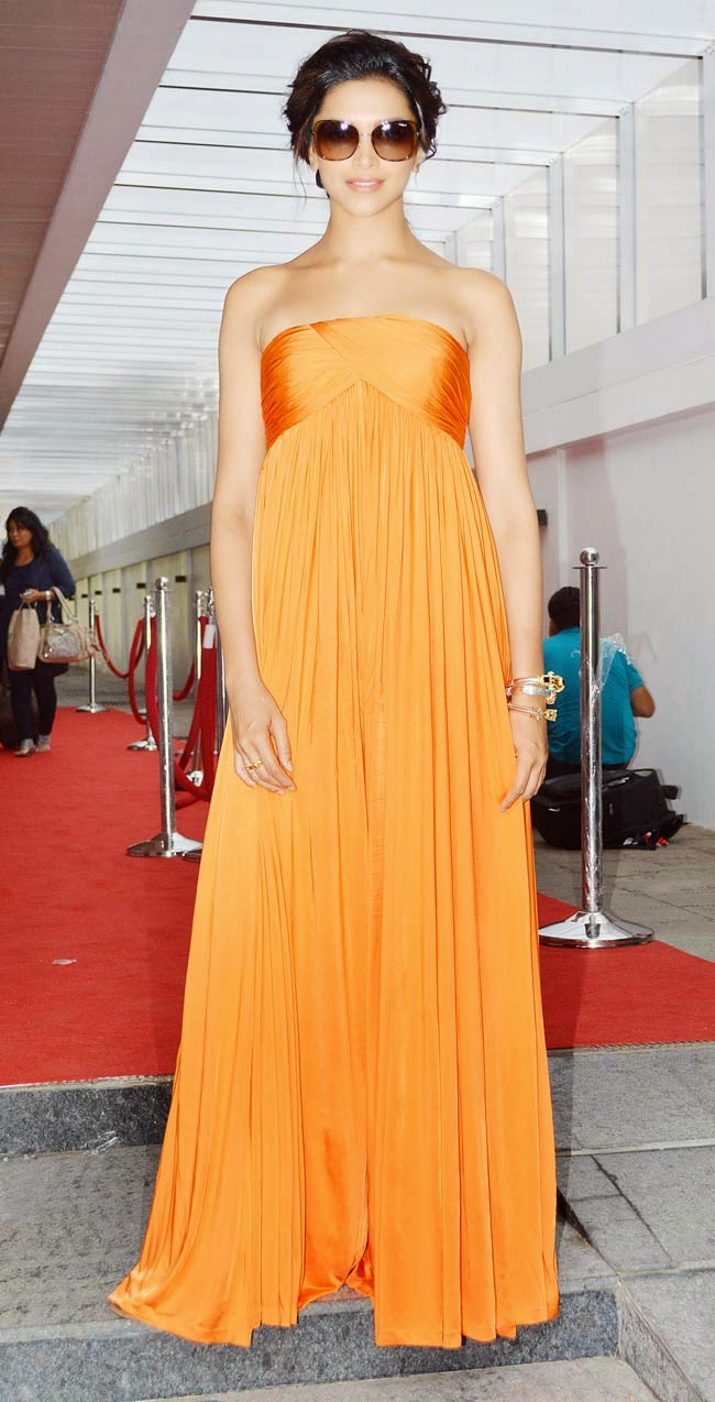 Deepika Padukone wearing Orange Dress for an event