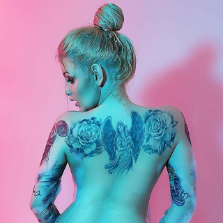 Tattoo on girl back shoulder