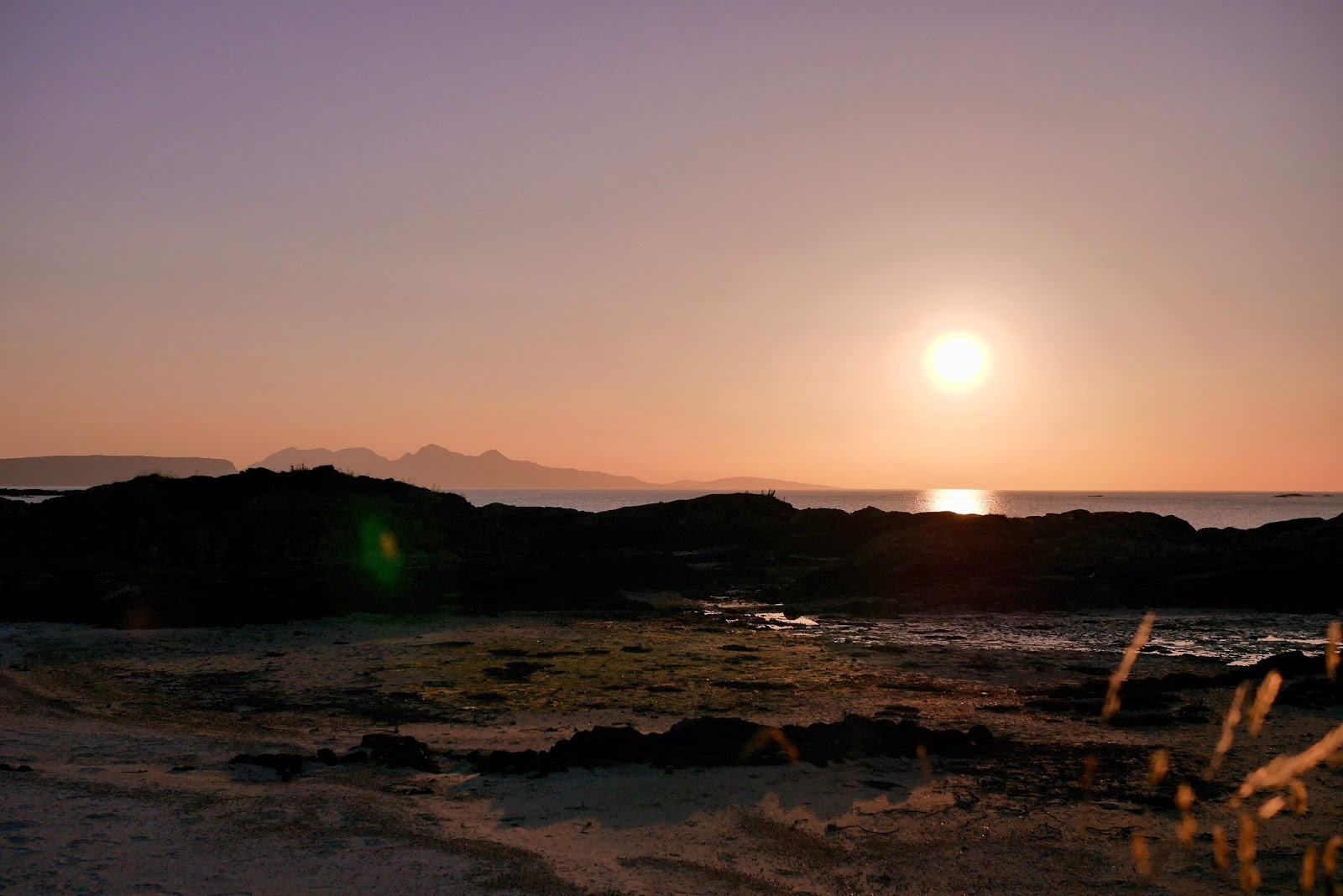 Incredible sunset views of the sky glowing orange and red accross the west in Arisaig, www.CalMcTravels.com