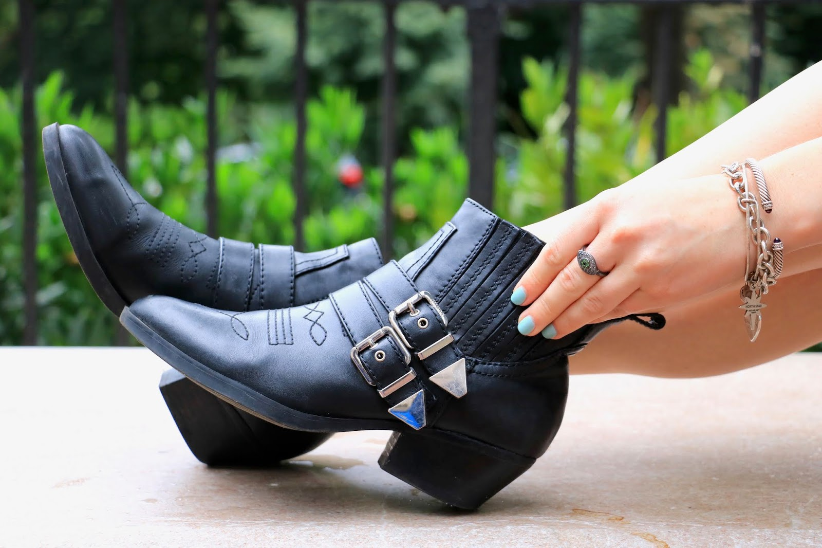 Nyc fashion blogger Kathleen Harper wearing black buckle booties from Guess