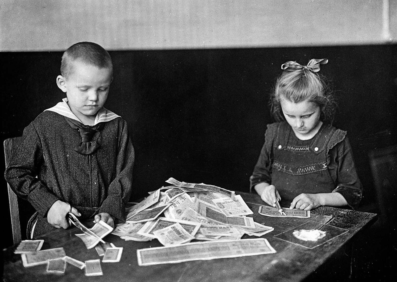 Children play with virtually worthless marks. 1922.