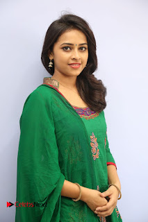 Actress Sri Divya Pictures in Green Salwar Kameez at Rayudu Team Meet  0070.JPG